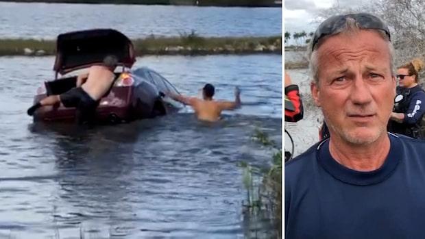 Ser hur kvinnan kör i vattnet – då kastar sig männen efter