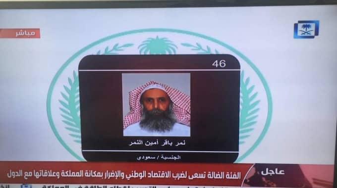 Saudisk tv visade upp en bild på den avrättade Nimr al-Nimr. Foto: Jon Gambrell/AP