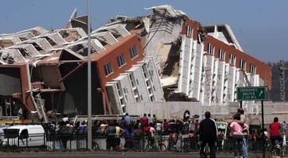 Byggnad i Concepcíon i Chile förstördes i skalvet. Foto: AP