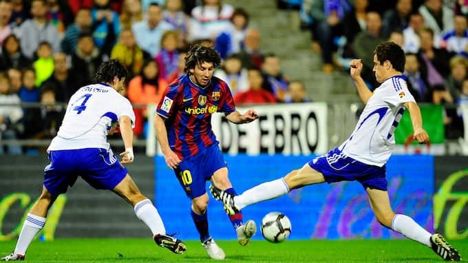 Dåvarande Zaragozaspelaren Herrera, till höger, blockar skott av Messi. Foto: DAVID RAMOS / AP