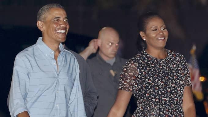 Barack och Michelle Obama är på semesterturné. Tidigare i år besökte de den Hawaiianska ön Oahu. Foto: CAROLYN KASTER