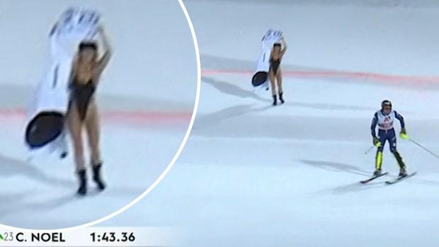 Skandalscener i alpina världscupen – kvinna i baddräkt stormar målfållan